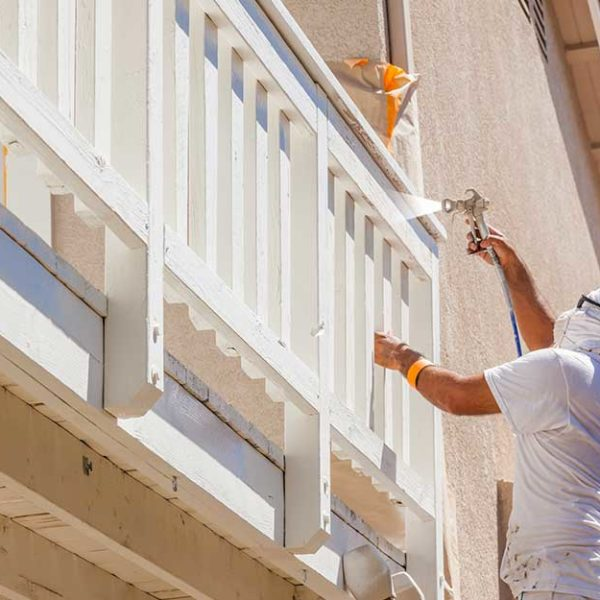 male painting the house balustre